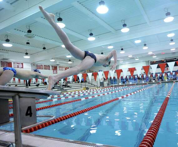 Thomas Dillinger of Greenwich goes off the block in the 200 freestyle event in the boys high school swim meet between Greenwich High School and Staples High School at Greenwich, Wednesday, Jan. 30, 2013. Photo: Bob Luckey / Greenwich Time