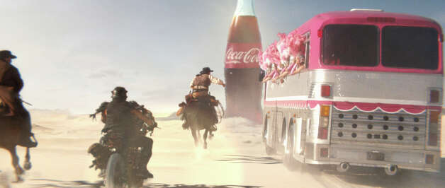 A Coca-Cola advertisement for Super Bowl XLVIII featuring a chase through the desert by cowboys, showgirls and motorcycle toughs in an undated handout photo. Each year within the Super Bowl, Madison Avenue plays an Ad Bowl, and two categories of products usually account for a supersize amount of spots: automobiles and beverages. (Handout via The New York Times) -- NO SALES; FOR EDITORIAL USE ONLY WITH STORY SLUGGED SUPER BOWL ADS. ALL OTHER USE PROHIBITED. -- Photo: HANDOUT, New York Times / HANDOUT