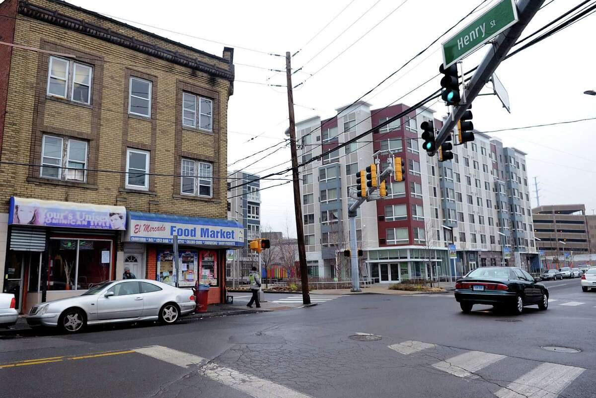 El Mercado Food Market and Your's Unisex hair salon occupy a building the state is proposing to demolish at the intersection of Henry and Atlantic Streets in Stamford.