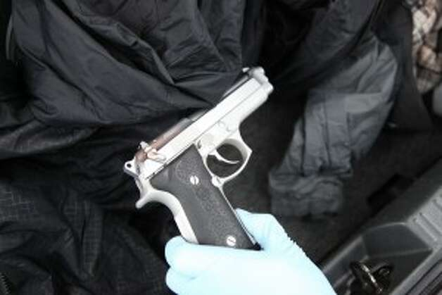 "Police say this pistol was turned over to the ""hitman."" Seattle police photo."