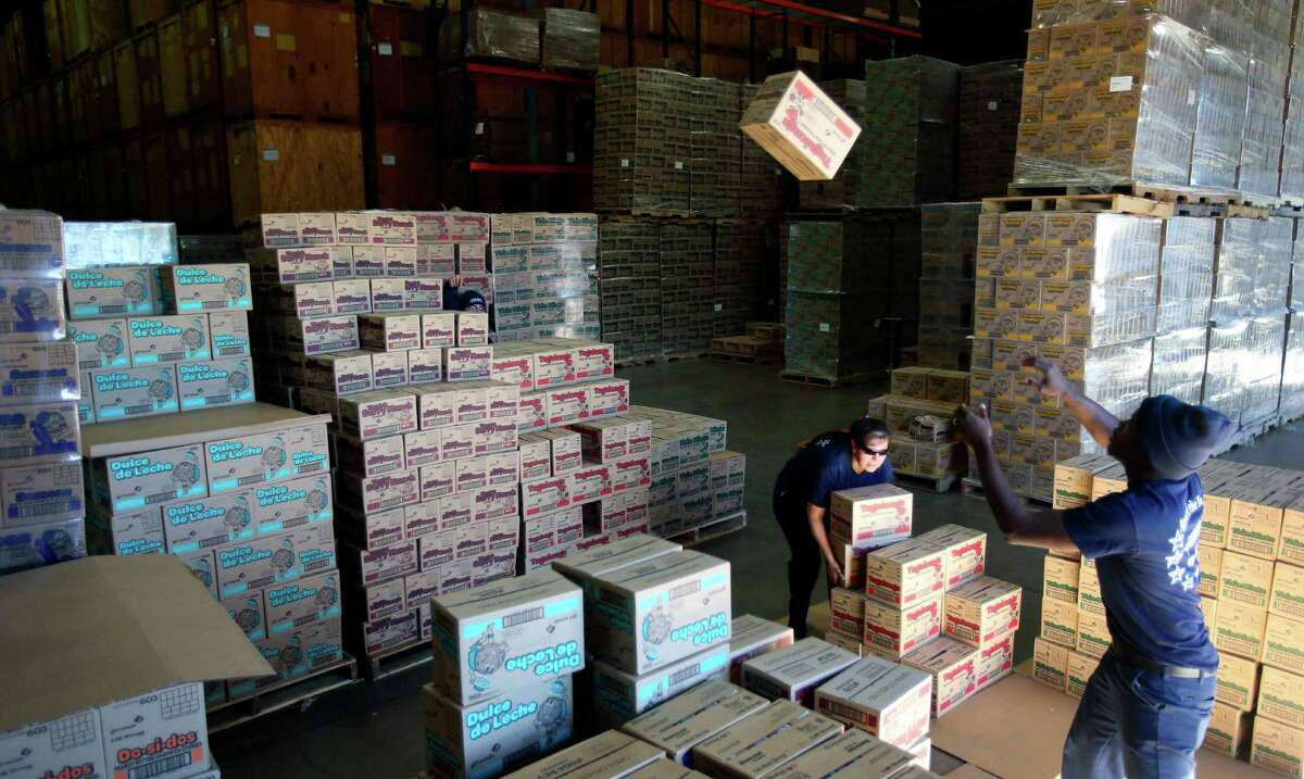 James Cunningham reaches up Wednesday, Jan. 30, 2012 to grab a box of Girl Scout cookies tossed to him by a co-worker (not seen) as distribution of 1.38 million cookies begins for the Girl Scouts of Southwest Texas which serves 23,500 girls in a 21 county area. Distribution continues through Feb. 2 and officials said to expect to see Girl Scouts in front of area stores starting Feb. 8.