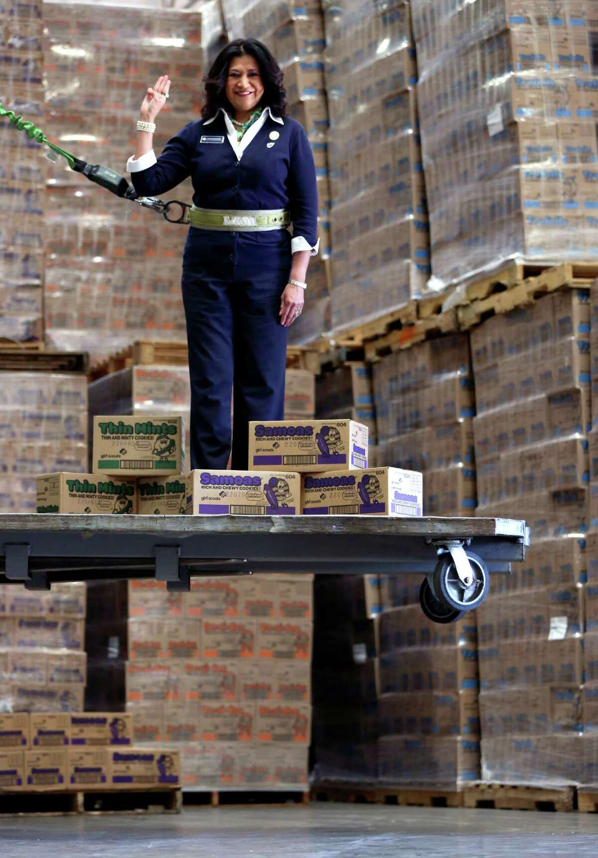 Girl Scouts Cookie Delivery in 2013. Girl Scouts of Southwest Texas CEO Rose Gonzalez Perez gives the scout salute Wednesday, Jan. 30, 2013 as she poses with some of the 1.38 million cookies set to be distributed in the next few days by the council which serves 23,500 girls in a 21 county area.