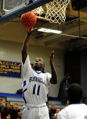 Bunnell's #11 Adam Samuel goes up for two points, during boys basketball action against Notre Dame of Fairfield in Stratford, Conn. on Tuesday January 29, 2013. Photo: Christian Abraham / Connecticut Post