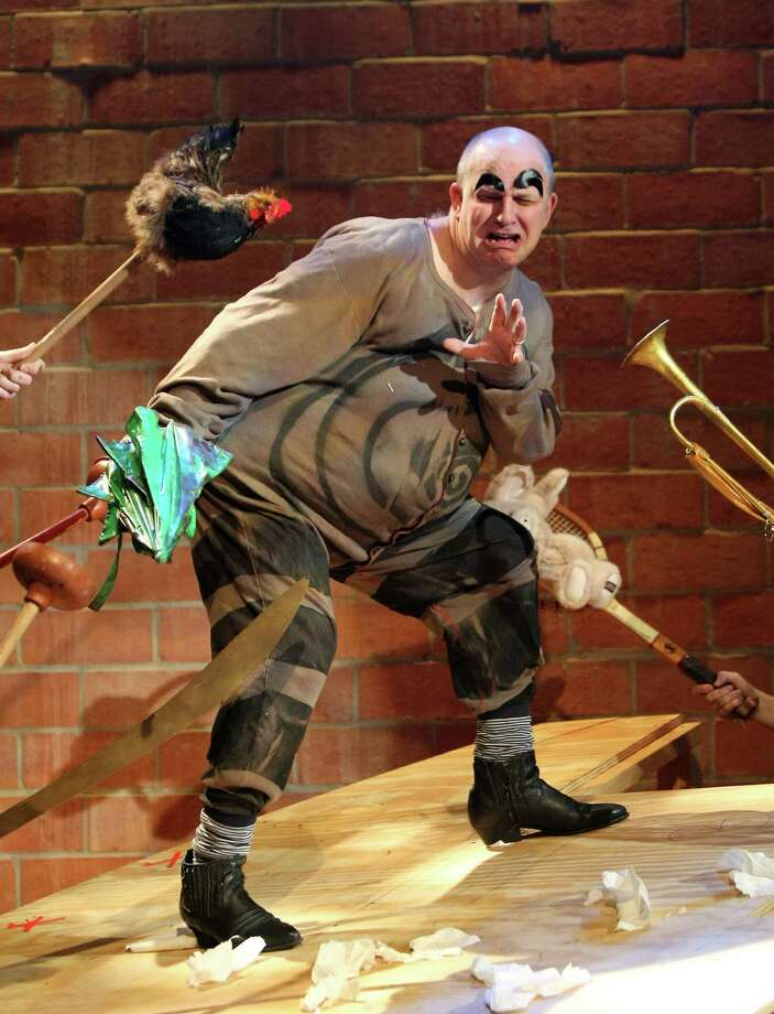 "Father Ubu (Mark Roberts) comes under attack in Alfred Jarry's play ""Ubu Roi."" Photo: Nick De La Torre, Staff / © 2013  Houston Chronicle"