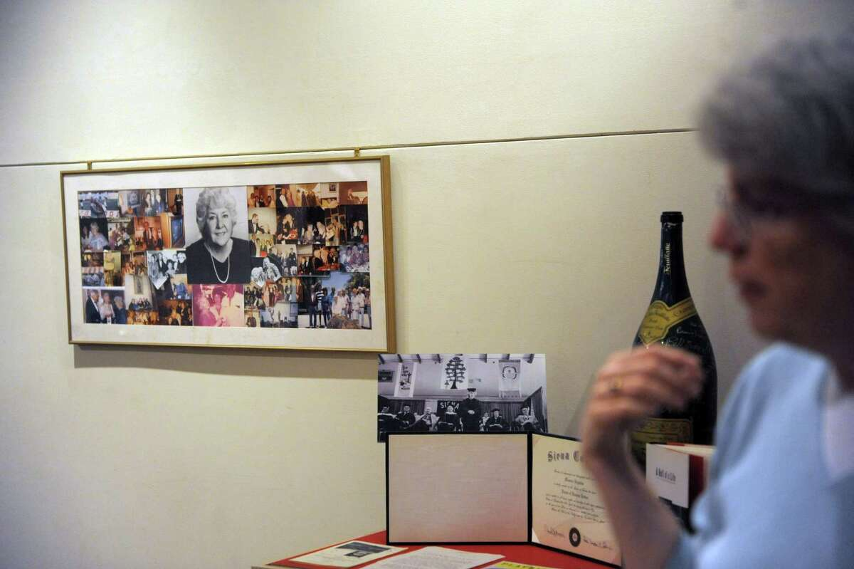 A photo collage of Maureen Stapleton with family and friends hangs on the wall at the Rensselaer County Historical Society on Wednesday, Jan. 30, 2013 in Troy, NY. The society is creating an exhibit entitled