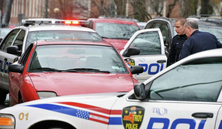 Troy police stop a vehicle thought to have been involved in a robbery on Second Street near Congress Street in Troy Wednesday Jan. 30, 2013.  (John Carl D'Annibale / Times Union) Photo: John Carl D'Annibale