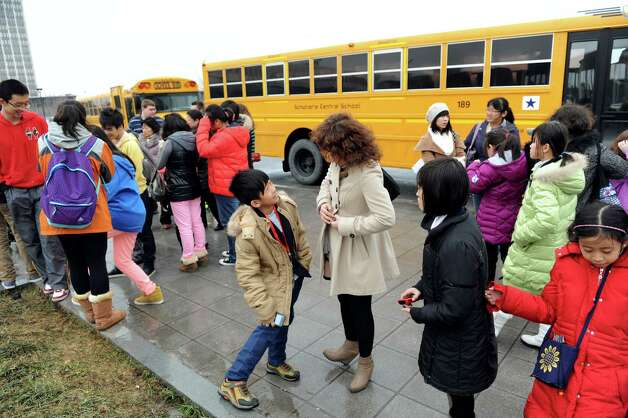A delegation of students and educators from Tianjin, China, unload as they prepare for a tour on Wednesday, Jan. 30, 2013, at University at Albany in Albany, N.Y. Tech Valley High School is hosting the delegation as well as the Schoharie, Schodack and Catskill central school districts. Tech Valley High School, Capital Region and Questar IIII BOCES has a sister-school agreement with Tianjin High School No. 41. (Cindy Schultz / Times Union) Photo: Cindy Schultz / 00020972A