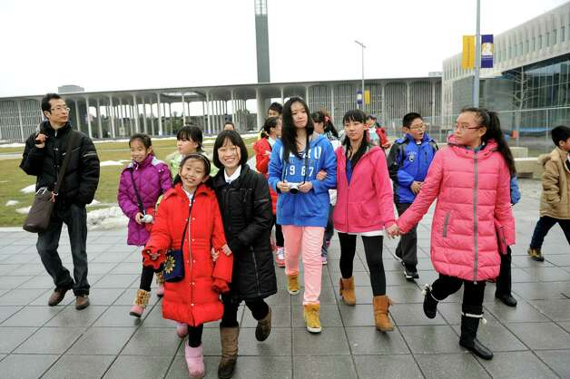 A delegation of students and educators from Tianjin, China tour campus on Wednesday, Jan. 30, 2013, at University at Albany in Albany, N.Y. Tech Valley High School is hosting the delegation as well as the Schoharie, Schodack and Catskill central school districts. Tech Valley High School, Capital Region and Questar IIII BOCES has a sister-school agreement with Tianjin High School No. 41. (Cindy Schultz / Times Union) Photo: Cindy Schultz / 00020972A