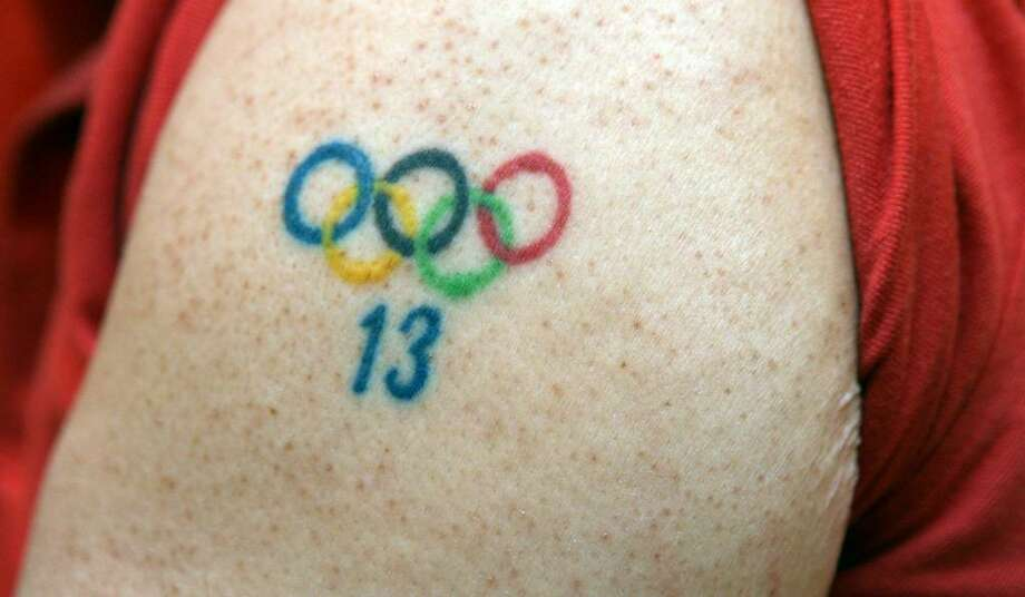 Family members of  Julie Chu, US Hockey Olympian, had the Olympic rings and Julie's number tattooed on their bodies before the 2002  Olympics. Julie, her mother, and sister had their ankles tattooed; her brother and father had their arms tattooed. Photo: B.K. Angeletti / Connecticut Post