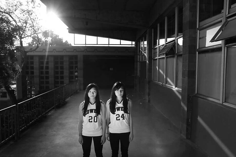 Twin sisters Julia and Cynthia Wong, 16, juniors at Lowell High School on January 29, 2013 in San Francisco, Calif. Cynthia is three minutes older that her sister. Photo: Mike Kepka, The Chronicle