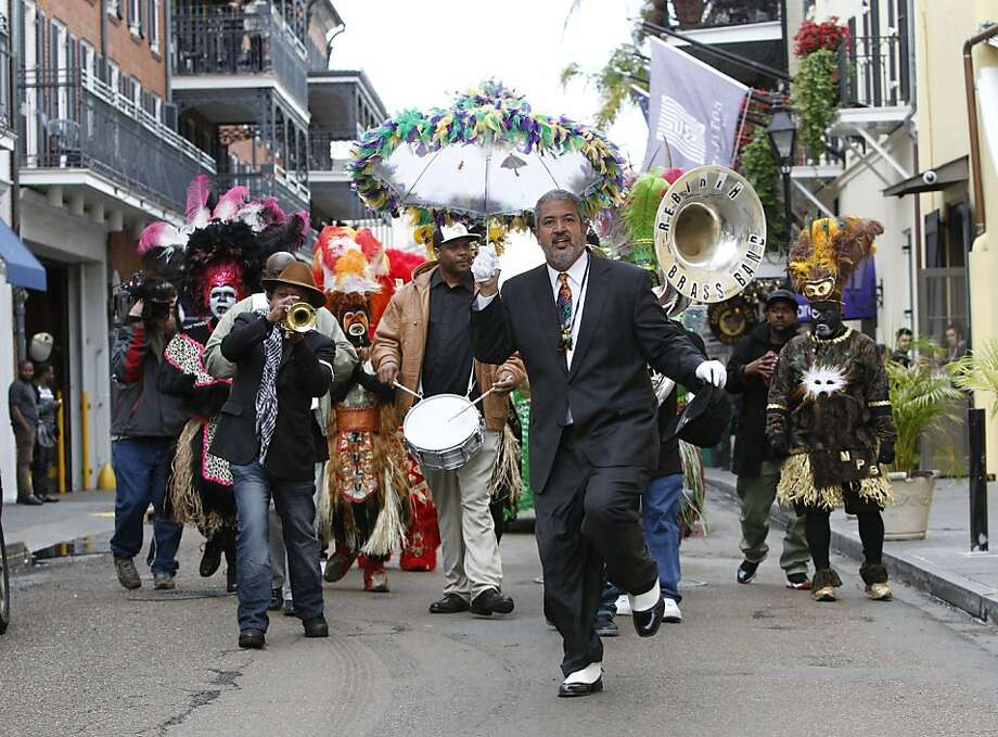 Chef Andrew LeDuff leads a jazz band in a Mardi Gras parade in the French Quarter of New Orleans. Photo: Carlos Avila Gonzalez, The Chronicle