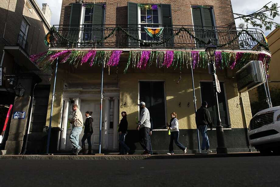 Banners hang from a French Quarter balcony in preparation for next month's Mardi Gras. Photo: Carlos Avila Gonzalez, The Chronicle