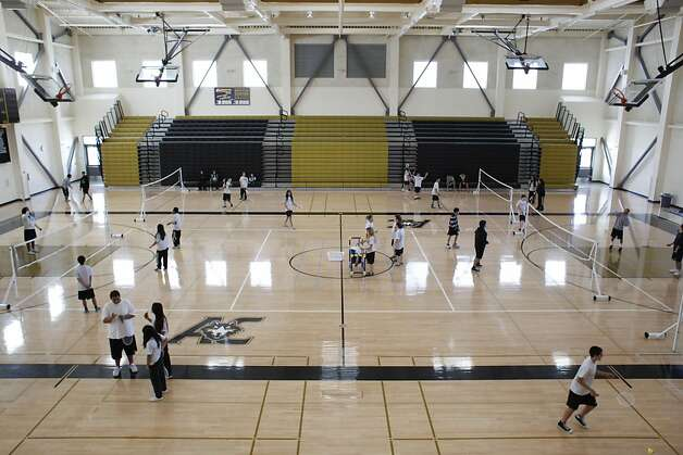 Students play badminton in the lower gym at American Canyon High School on Tuesday Jan. 29, 2013 in American Canyon, Calif.  In 2006, Napa voters authorized $183 million to repair old school buildings and build a new high school in American Canyon, a rapidly growing area in southern Napa County. By 2009, when the high school was nearly completed, property values had dropped and the district suddenly found itself short of cash. On the advice of KNN Public Finance, an Oakland firm, Napa issued a nearly$22 million capital appreciation bond. Photo: Mike Kepka, The Chronicle