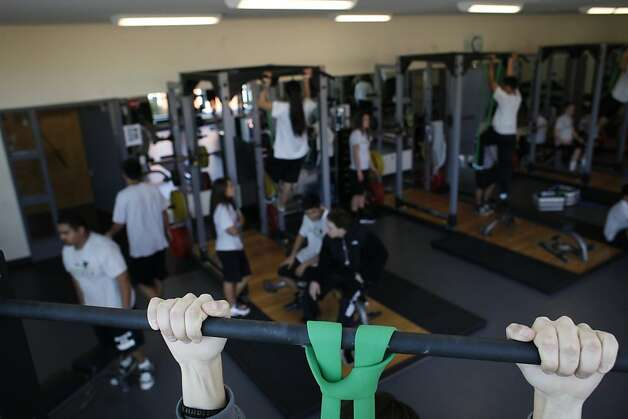 Students work out in the weight room at American Canyon High School on Tuesday Jan. 29, 2013 in American Canyon, Calif.  In 2006, Napa voters authorized $183 million to repair old school buildings and build a new high school in American Canyon, a rapidly growing area in southern Napa County. By 2009, when the high school was nearly completed, property values had dropped and the district suddenly found itself short of cash. On the advice of KNN Public Finance, an Oakland firm, Napa issued a nearly$22 million capital appreciation bond. Photo: Mike Kepka, The Chronicle