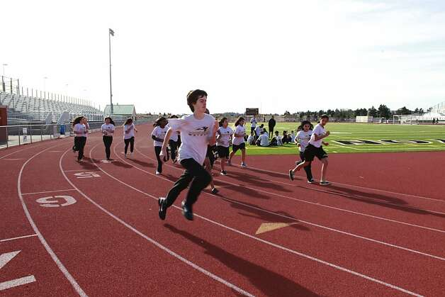 Students run around a state of the art track and field stadium at American Canyon High School on Tuesday Jan. 29, 2013 in American Canyon, Calif.  In 2006, Napa voters authorized $183 million to repair old school buildings and build a new high school in American Canyon, a rapidly growing area in southern Napa County. By 2009, when the high school was nearly completed, property values had dropped and the district suddenly found itself short of cash. On the advice of KNN Public Finance, an Oakland firm, Napa issued a nearly$22 million capital appreciation bond. Photo: Mike Kepka, The Chronicle