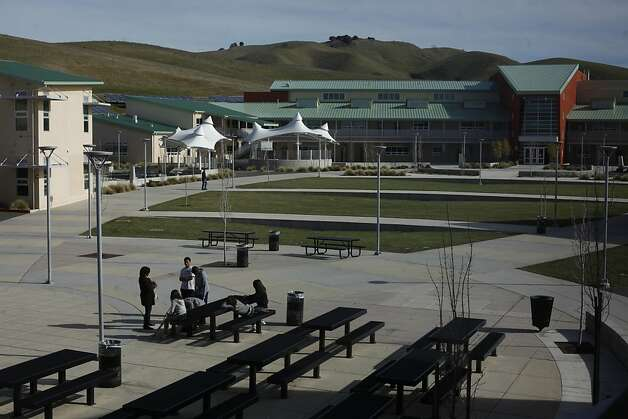 Students hang out in the main quad at American Canyon High School on Tuesday Jan. 29, 2013 in American Canyon, Calif.  In 2006, Napa voters authorized $183 million to repair old school buildings and build a new high school in American Canyon, a rapidly growing area in southern Napa County. By 2009, when the high school was nearly completed, property values had dropped and the district suddenly found itself short of cash. On the advice of KNN Public Finance, an Oakland firm, Napa issued a nearly$22 million capital appreciation bond. Photo: Mike Kepka, The Chronicle