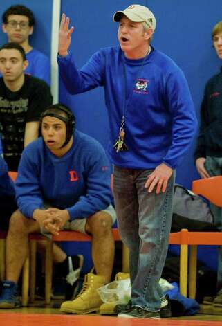 Danbury High School wrestling coach Ricky Shook shouts instructions to his wrestler during a match against Fairfield Warde High School, at Danbury. Wednesday, Jan. 30, 2013 Photo: Scott Mullin / The News-Times Freelance
