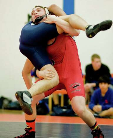 Fairfield Warde High School's Thomas Anania lifts Danbury High School's Miguel Perdomo in the 182 lb. match at Danbury. Wednesday, Jan. 30, 2013 Photo: Scott Mullin / The News-Times Freelance