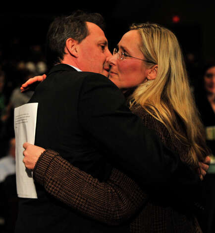 Neil Heslin hugs Scarlett Lewis after Lewis testified before the Connecticut Bipartisan Task Force on Gun Violence Prevention and Children's Safety at Newtown High School on Wednesday, Jan. 30, 2013. Heslin and Lewis are parents of Sandy Hook Elementary School shooting victim Jesse Lewis.  The task force was created in response to the shooting at Sandy Hook Elementary School. Photo: Jason Rearick / The News-Times