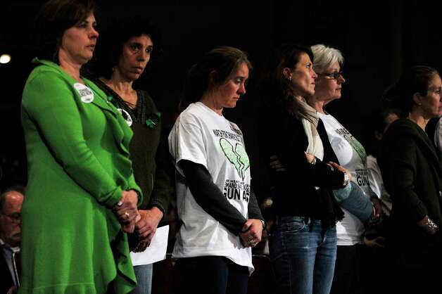 Members of March for Change stand as their representative speaks during Connecticut's Bipartisan Task Force on Gun Violence Prevention and Children's Safety at Newtown High School on Wednesday, Jan. 30, 2013. The task force was created in response to the shooting at Sandy Hook Elementary School. Photo: Jason Rearick / The News-Times