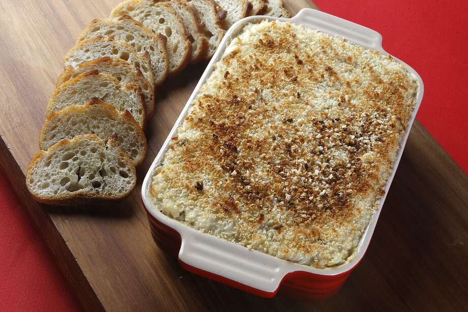 Hot crab dip with toasted baguette slices photographed in San Francisco, Calif.,  on Wednesday, January 30, 2013.  Styled by Sarah Fritsche. Photo: Liz Hafalia, The Chronicle