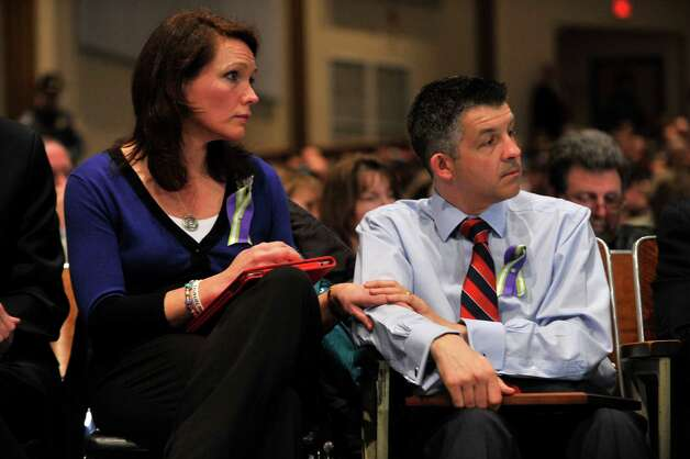 Nicole and Ian Hockley hold hands during Connecticut's Bipartisan Task Force on Gun Violence Prevention and Children's Safety at Newtown High School on Wednesday, Jan. 30, 2013. The task force was created in response to the shooting at Sandy Hook Elementary School. Nicole and Ian are the parents of Sandy Hook Elementary School shooting victim Dylan Hockley. Photo: Jason Rearick / The News-Times