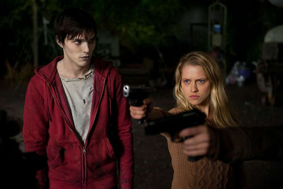"Zombie R (Nicholas Hoult) feels a jolt when he meets Julie (Teresa Palmer) in ""Warm Bodies."" Photo: Jonathan Wenk, Summit Entertainment"