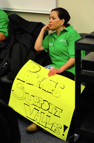 Claudia Phillips, with Parents for Progress, listens as Superintendent of Schools Paul Vallas speaks to the Bridgeport Board of Education about why he should receive a good evaluation and contract extension, during a meeting at Bridgeport City Hall in Bridgeport, Conn. on Wenesday January 30, 2013. Photo: Christian Abraham / Connecticut Post
