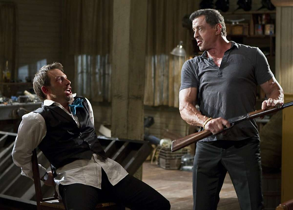 (L-r) CHRISTIAN SLATER as Marcus Baptiste and SYLVESTER STALLONE as Jimmy in Warner Bros. Pictures?•, Dark Castle Entertainment?•s and IM Global?•s action thriller ?'BULLET TO THE HEAD,?