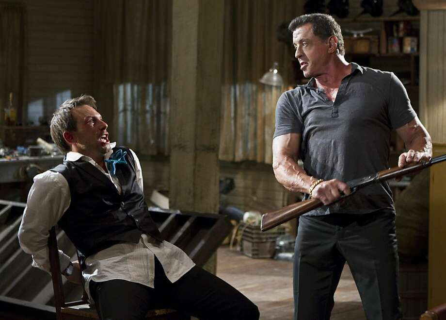 "Christian Slater (left) and Sylvester Stallone star in ""Bullet to the Head,"" which earned Stallone's lowest opening yet for a wide release. Photo: Frank Masi, Warner Bros."