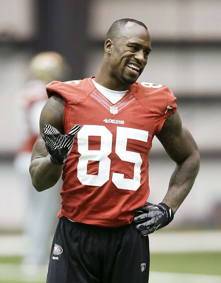 San Francisco 49ers tight end Vernon Davis discusses a pass route during practice on Wednesday, Jan. 30, 2013, in New Orleans. The 49ers are scheduled to play the Baltimore Ravens in the NFL Super Bowl XLVII football game on Feb. 3. (AP Photo/Mark Humphrey) Photo: Mark Humphrey, Associated Press