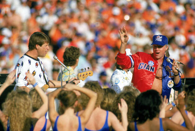 Super Bowl XXI — Jan. 25, 1987 | Pasadena, Calif. | Giants 39, Broncos 20Performers: Southern California high school drill teams and dancers, Disney characters.The Beach Boys performed before the game (pictured) and Neil Diamond sang the national anthem. The halftime show was was introduced by comedian George Burns and was themed, ''Salute to Hollywood's 100th Anniversary.'' It was produced by Disney.You can watch the entire halftime show on YouTube. Photo: George Rose, Getty Images / 1987 Getty Images
