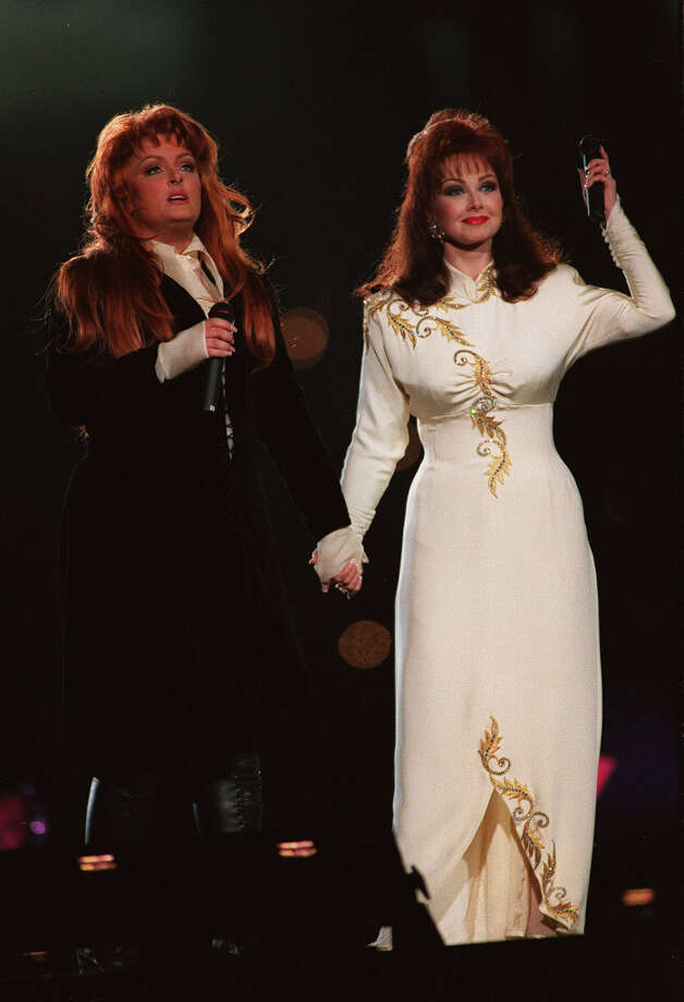 Super Bowl XXVIII— Jan. 30, 1994 | Atlanta | Cowboys 30, Bills 13Performers: Clint Black, Tanya Tucker, Travis Tritt, Brooks & Dunn, Wynonna Judd and Naomi Judd (pictured).The halftime show went country with an ensemble of big country music artists in 1994. The theme was ''Rockin' Country Sunday.'' Photo: Stephen Dunn, Getty Images / Getty Images North America