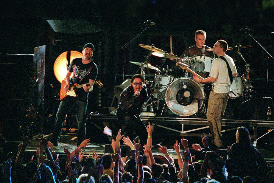 Super Bowl XXXVI — Feb. 3, 2002 | New Orleans | Patriots 20, Rams 17Performers: U2.With 9/11 fresh in the minds of all Americans, the halftime show in 2002 was a tribute to the men and women lost in the terrorist attacks the year before. Two backdrops behind the band showed the names of the victims, and lead singer Bono wore a jacket lined with the American flag.You can watch the entire halftime show on YouTube. Photo: Joe Robbins, Getty Images / 2002 Joe Robbins