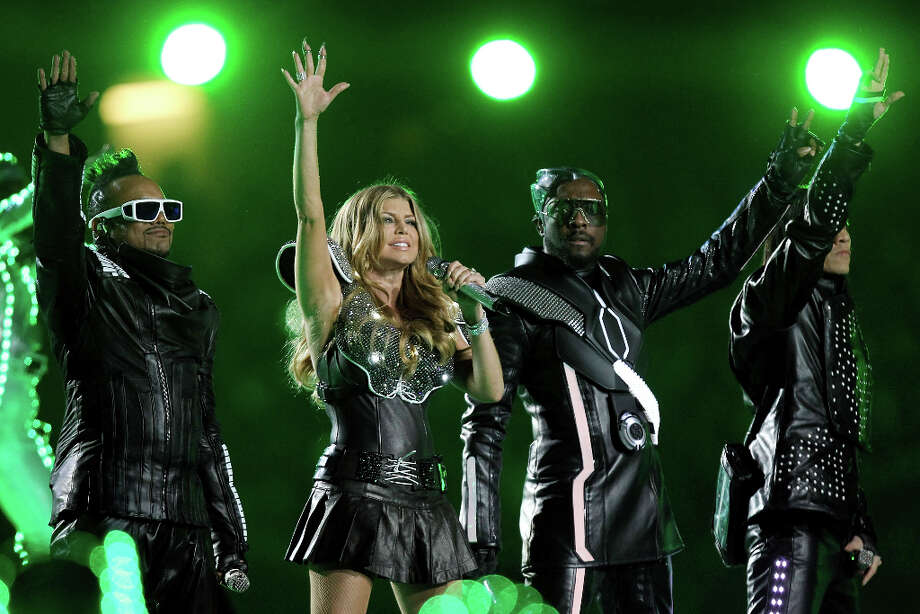 Super Bowl XLV — Feb. 6, 2011 | Arlington, Texas | Packers 31, Steelers 25Performers: Black Eyed Peas, Usher, Slash.For the first time in several years, this halftime show had a theme: ''Tron Legacy,'' for the movie that came out that year. It was mainly a Black Eyed Peas performance, but Slash of Guns 'n' Roses took the stage to play ''Sweet Child o' Mine'' and Usher went up to perform his ''OMG.''You can watch the entire halftime show on YouTube. Photo: Ronald Martinez, Getty Images / 2011 Getty Images