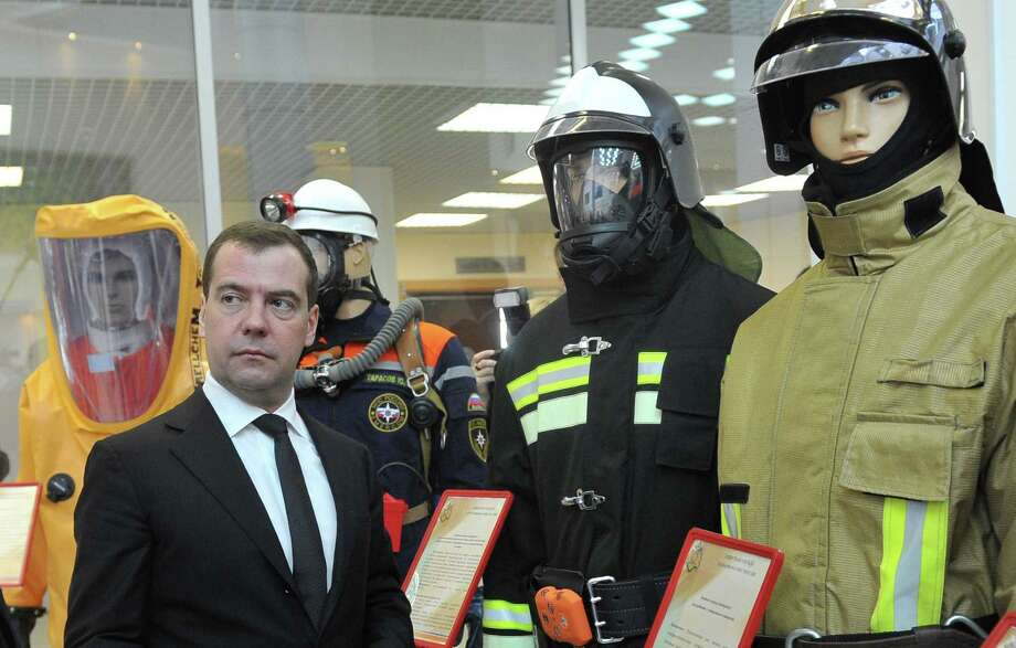 Russian Prime Minister Dmitry Medvedev, front left, visits an exhibition of rescue equipment in Krasnogorsk, outside Moscow, Wednesday, Jan. 30, 2013. (AP Photo/RIA Novosti, Alexander Astafyev, Government Press Service) Photo: Alexander Astafyev