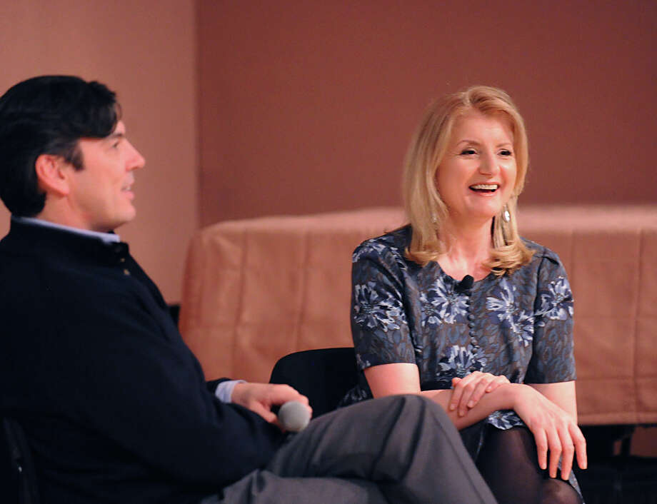 At left, Greenwich resident Tim Armstrong, chief executive officer of AOL, and Arianna Huffington, president of the Huffington Post Media Group, speak about the future of the internet during the Junior League of Greenwich membership meeting at Greenwich Library, Wednesday night, Jan. 30, 2013. Photo: Bob Luckey / Greenwich Time
