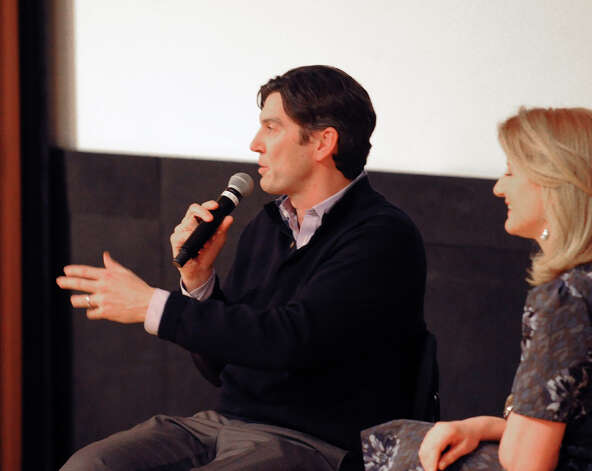 At left, Greenwich resident Tim Armstrong, chief executive officer of AOL, and Arianna Huffington, president of the Huffington Post Media Group, speak during the Junior League of Greenwich membership meeting at Greenwich Library, Wednesday night, Jan. 30, 2013. Photo: Bob Luckey / Greenwich Time