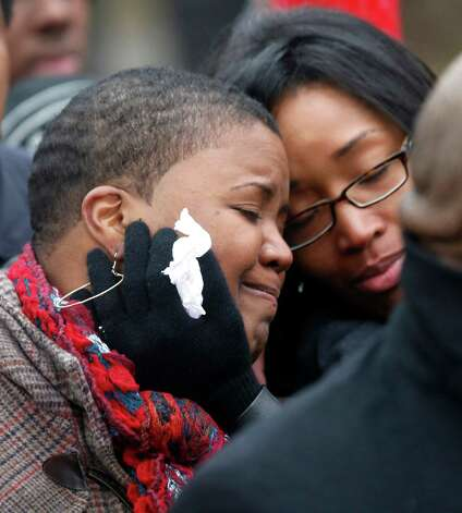 Cleopatra Pendelton, left, is consoled by her sister Kimiko Pettis, during a news conference with Chicago Police Superintendent Garry McCarthy seeking help from the public in solving the murder of Pendelton's daughter Hadiya Wednesday, Jan. 30, 2013, in Chicago.  Hadiya, 15, who had performed in President Barack Obama's inauguration festivities, was killed in a Chicago park as she talked with friends by a gunman who apparently was not even aiming at her. The city's 42nd slaying is part of Chicago's bloodiest January in more than a decade, following on the heels of 2012, which ended with more than 500 homicides for the first time since 2008. It also comes at a time when Obama, spurred by the Connecticut elementary school massacre in December, is actively pushing for tougher gun laws. (AP Photo/Charles Rex Arbogast) Photo: Charles Rex Arbogast
