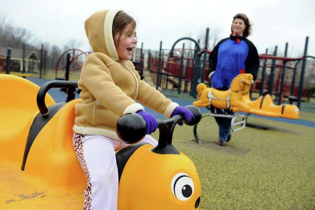 Emily Lacey, 4, of Rotterdam, left, plays with her mother, Kimberly, on Wednesday, Jan. 30, 2013, at The Crossings in Colonie, N.Y. Kimberly is expecting a baby in September. (Cindy Schultz / Times Union) Photo: Cindy Schultz / 00020979A