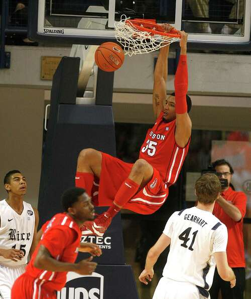 The University of Houston's Tashawn Thomas slams it home.