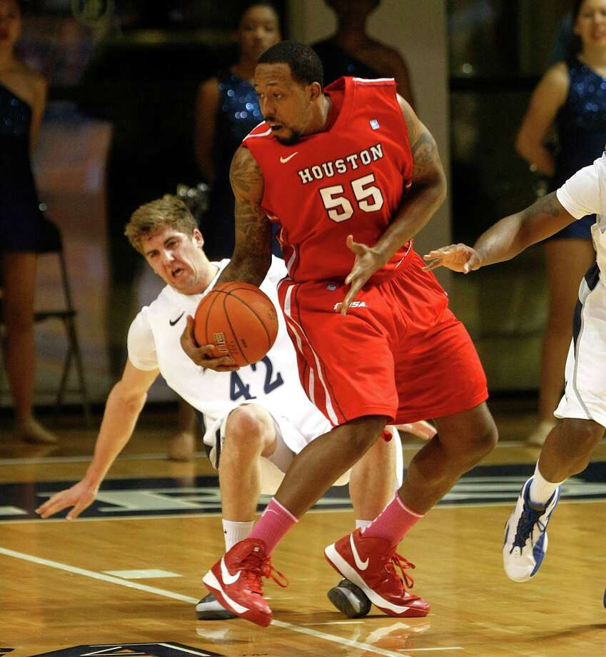 Rice University's Austin Ramljak falls to the floor after being pushed back by the University of Houston's J.J. Richardson. Photo: Johnny Hanson, Houston Chronicle / © 2013  Houston Chronicle