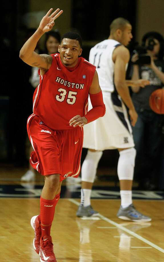 The University of Houston's Tashawn Thomas celebrates a three-point basket by teammate Joseph Young. Photo: Johnny Hanson, Houston Chronicle / © 2013  Houston Chronicle