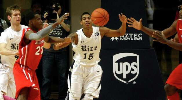 Rice's Julian DeBose (15) battles for the ball against The University of Houston's Danuel House (23). Photo: Johnny Hanson, Houston Chronicle / © 2013  Houston Chronicle