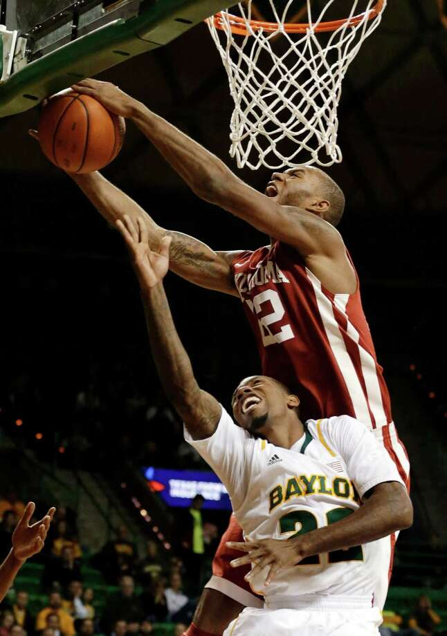 Oklahoma's Amath M'Baye (top) rejects Baylor 's A.J. Walton with two hands during the second half Wednesday. The Bears were denied their best start in conference play since 1968-69. Photo: Tony Gutierrez, Associated Press / AP