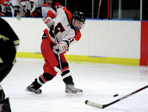 Fairfield Warde/Ludlowe's #11 Kevin Robinson, during boys hockey action against Trumbull at the Wonderland of Ice in Bridgeport, Conn. on Wednesday January 30, 2013. Photo: Christian Abraham / Connecticut Post