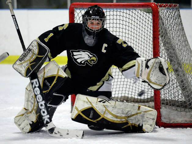 Trumbull goalie Matt Paolini tracks a puck, during boys hockey action against Fairfield Warde/Ludlowe at the Wonderland of Ice in Bridgeport, Conn. on Wednesday January 30, 2013. Photo: Christian Abraham / Connecticut Post