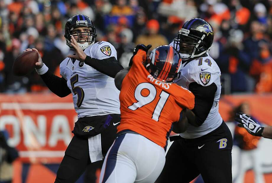 Baltimore Ravens quarterback Joe Flacco (5) steps back to pass as tackle Michael Oher (74) blocks Denver Broncos defensive end Robert Ayers (91) in the first quarter of an AFC divisional playoff NFL football game, Saturday, Jan. 12, 2013, in Denver. (AP Photo/Jack Dempsey) Photo: Jack Dempsey, Associated Press