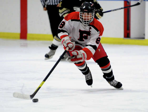 Fairfield Warde/Ludlowe's #8 Mike Aquila drives the puck, during boys hockey action against Trumbull at the Wonderland of Ice in Bridgeport, Conn. on Wednesday January 30, 2013. Photo: Christian Abraham / Connecticut Post