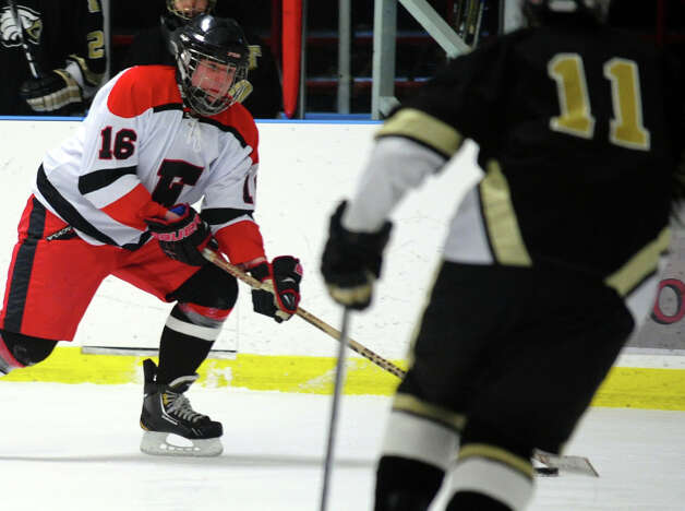 Fairfield Warde/Ludlowe's #16 Mathieu LaRouche drives the puck, during boys hockey action against Trumbull at the Wonderland of Ice in Bridgeport, Conn. on Wednesday January 30, 2013. Photo: Christian Abraham / Connecticut Post